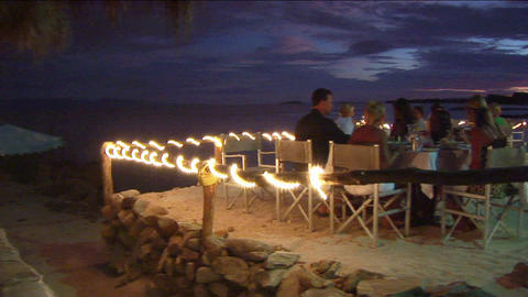Patrons dine at an outdoor beach restaurant Stock Video Footage