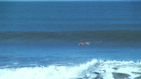 A surfer rides the course of a long surface wave before... Stock Video Footage