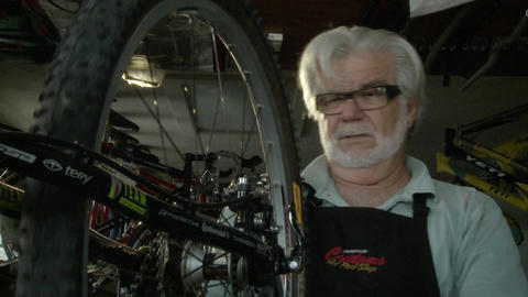 A repairman inspects a bicycle's tire Stock Video Footage