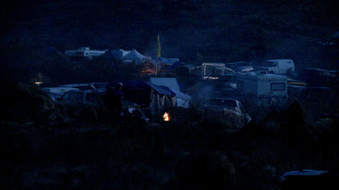 People have bonfires going at a campground Footage