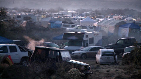 Smoke rises from fires at a campground Stock Video Footage