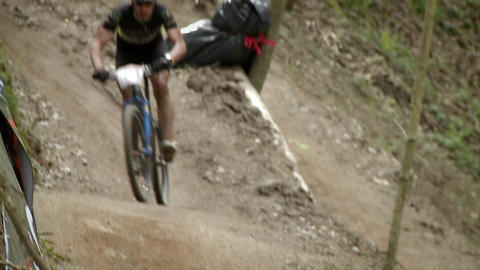 Bicyclists race through a wooded area Stock Video Footage