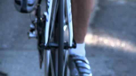 Feet pedal a bicycle Stock Video Footage