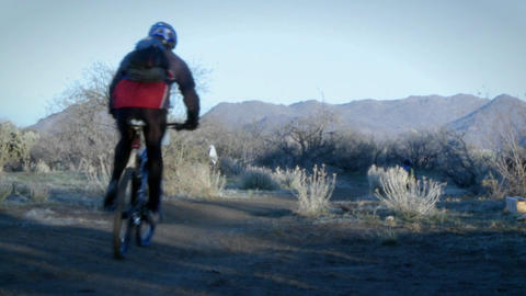 Several bikers ride on a mountain trail Stock Video Footage