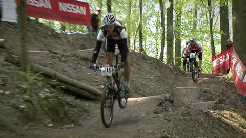 Cyclists race down rough terrain Footage