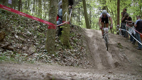 A group of bikers race down an off road trail Footage