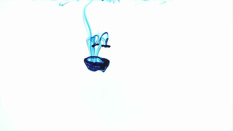Blue dye is immersed in a clear liquid Stock Video Footage
