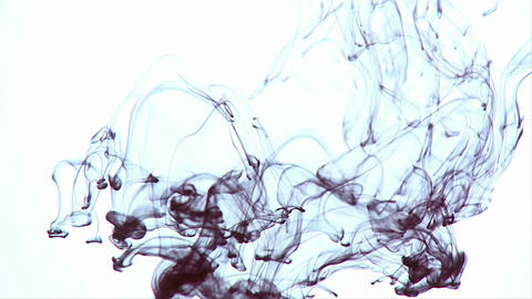 A dark colored ink is poured into a liquid and slowly... Stock Video Footage