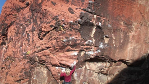 A climber ascends a rock face Stock Video Footage