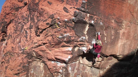 A climber ascends a rock face Footage