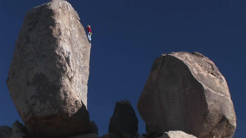 A climber begins to descend a rock face Stock Video Footage
