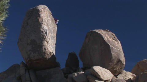 A climber begins to descend a rock face Footage