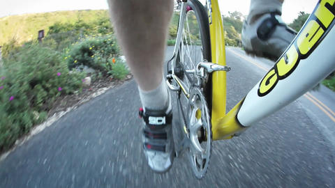 A man gets on a bicycle and rides down a street Stock Video Footage