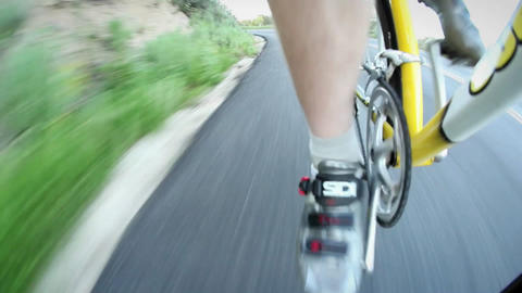 A bicyclist rides down a road Stock Video Footage