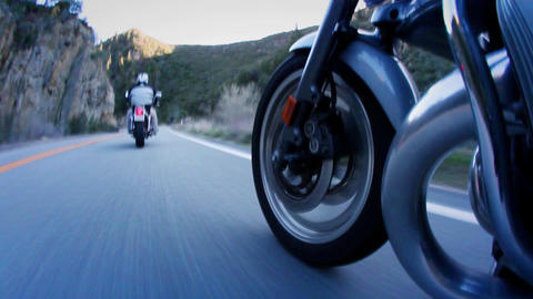 Motorcyclists are riding down a mountain highway Stock Video Footage