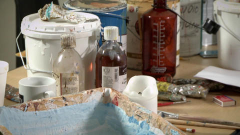 Painting supplies are laid out on a table Stock Video Footage