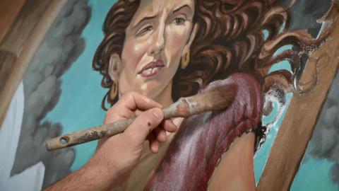 An artist paints a picture of a woman Stock Video Footage