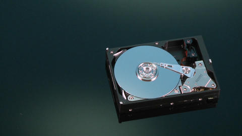 A hard drive without its cover rotates on display Footage