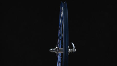 A blue bicycle rim rotates around Stock Video Footage