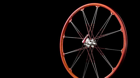 A wheel with spokes revolves Footage