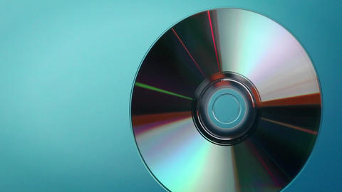A DVD disc revolves and turns Stock Video Footage