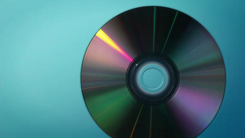 A DVD disc revolves and turns Footage