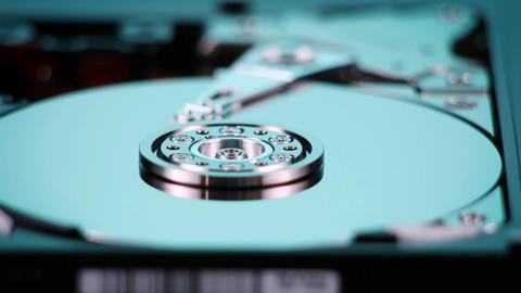 A hard drive with out cover spins slowly on display Stock Video Footage