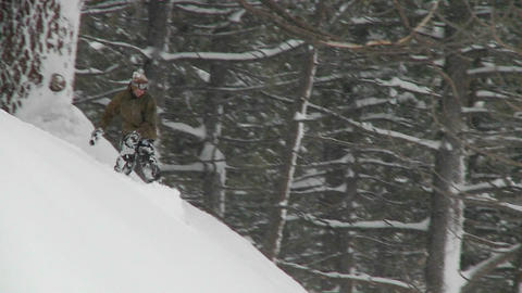 A man snow-boards down a slope Stock Video Footage