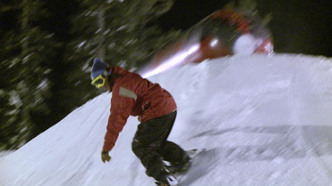 A snowboarder slides on top of a metal cylinder Stock Video Footage