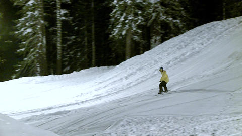 A snow boarder performs a stunt on a metal cylinder Footage