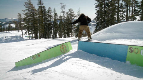 A man rides on a snowboard Footage