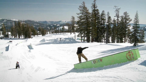 A man rides on a snowboard Stock Video Footage