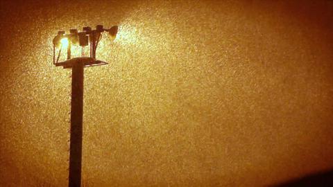 Floodlights shine through the rain Stock Video Footage