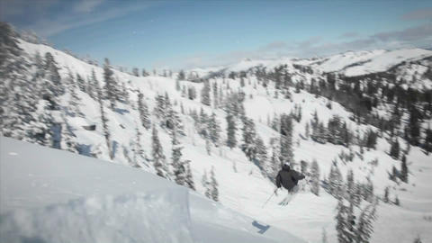 A skier does a flip as he is coming down the slope Stock Video Footage