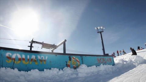 A snowboarder makes a slide and a jump Stock Video Footage