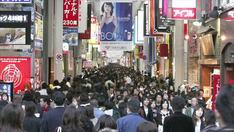 Huge crowds of shoppers in a colorful pedestrian mall in... Stock Video Footage