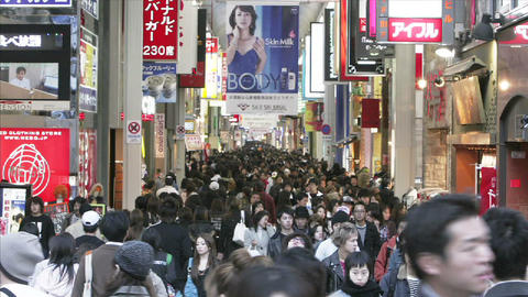 Huge crowds of shoppers in a colorful pedestrian mall in Osaka, Japan Footage