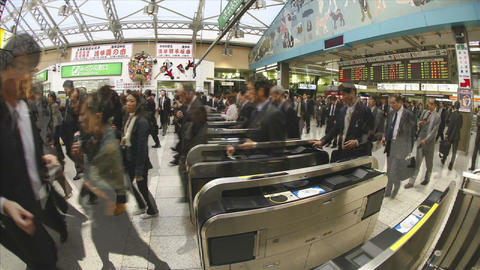Passengers walk through JR turnstiles in Ueno Station,... Stock Video Footage