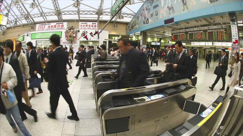 Passengers walk through JR turnstiles in Ueno Station,... Stock Video Footage