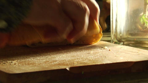 Hands gather slices of bread Footage