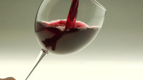 Red wine is poured into a goblet Footage