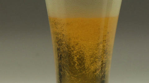 Beer bubbles in a Pilsner Stock Video Footage