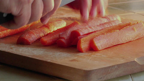 A chef slices carrots with a knife Stock Video Footage