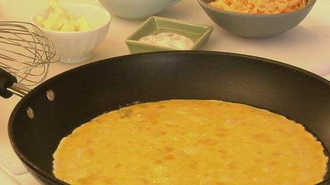 An omelet is cooked in a pan Stock Video Footage