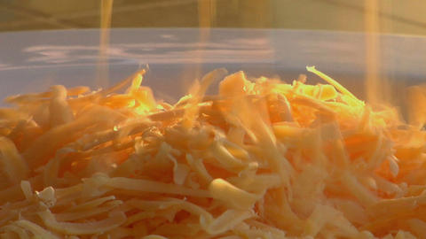 Grated cheese falls on the top of steaming scrambled eggs Stock Video Footage