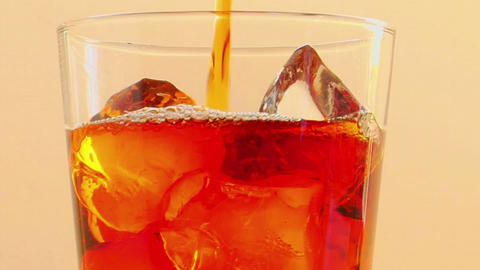 Tilt up to as liquor is poured into a glass with ice Stock Video Footage