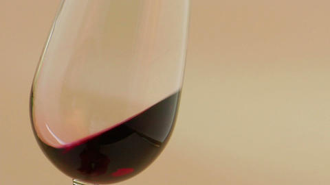 Red wine swirling in an elegant wine glass Stock Video Footage