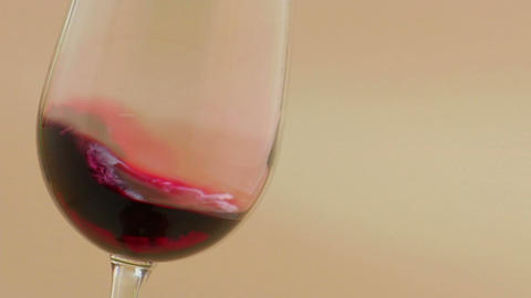 Red wine swirling in an elegant wine glass Footage