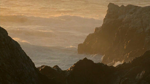 Winter waves and surf pound the rocks of the Big Sur Coast of California Footage