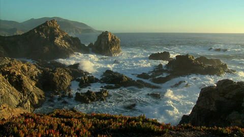 Waves and surf from a winter storm pound the Big Sur... Stock Video Footage